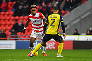 Mallik Wilks of Doncaster Rovers (7) takes on Jordan Clarke of Scunthorpe United (2) during the EFL Sky Bet League 1 match between Doncaster Rovers and Scunthorpe United at the Keepmoat Stadium, Doncaster, England on 15 December 2018.