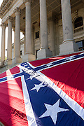 A gigantic Confederate flag is positioned on the steps of the South Carolina State Capitol building May 2, 2015 in Columbia, SC. Confederate Memorial Day is a official state holiday in South Carolina and honors those that served during the Civil War.