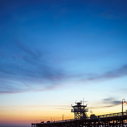 San Clemente pier at sunset picture. San Clemente is a popular beach town in Orange County California in the United States of America. Copyright ⓒ 2017 Paul Velgos with all rights reserved.
