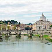 ROME, Italy - Tiber River in the middle of Rome, looking towards St. Peter's Cathedral and the Vatican