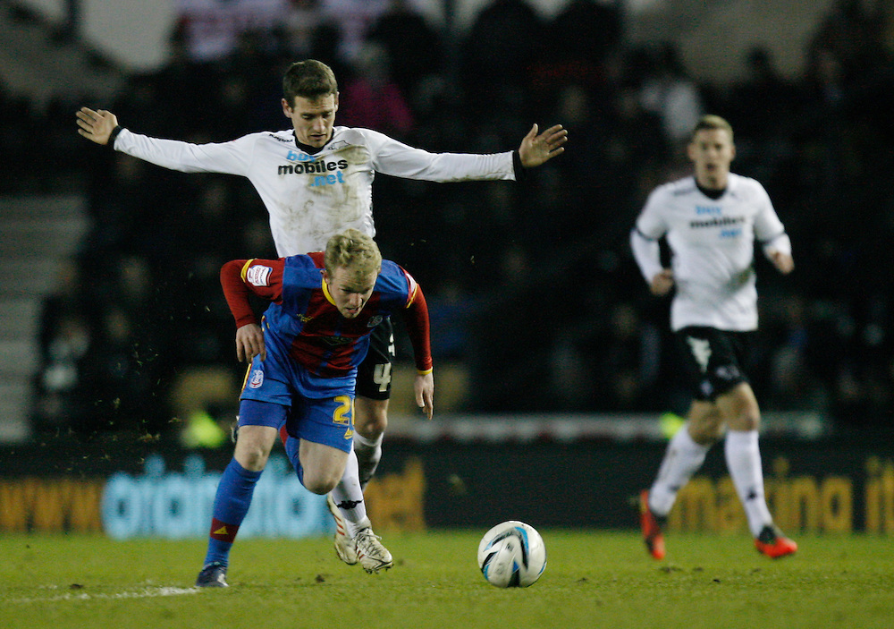 Crystal Palace's Jonathan Williams (C) is fouled by Derby County's Craig Bryson ...Football - npower Football League Championship - Derby County v Crystal Palace - Friday 01st March 2013 - Pride Park - Derby..© CameraSport - 43 Linden Ave. Countesthorpe. Leicester. England. LE8 5PG - Tel: +44 (0) 116 277 4147 - admin@camerasport.com - www.camerasport.com
