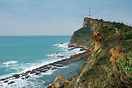 """The """"bean curd"""" rocks can be seen below the Gueitou Mountain, out on the end of the peninsula.  The angled shape of the cliff is called """"cuesta"""" and can be seen all over Taiwan."""