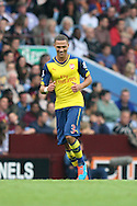 Kieran Gibbs of Arsenal affords himself a smile after his strike is deflected into the goal for his team's third goal. Barclays Premier league match, Aston Villa v Arsenal at Villa Park in Birmingham on Saturday 20th Sept 2014<br /> pic by Mark Hawkins, Andrew Orchard sports photography.