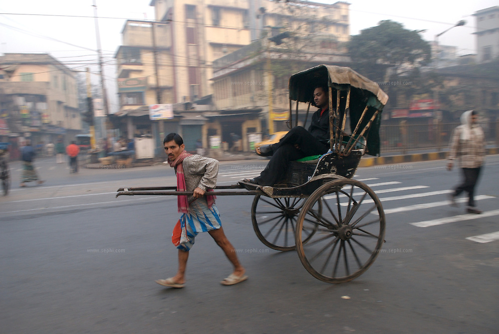 """The hand-pulled rickshaw of Calcutta, immortalised by Dominic Lapierre's famous novel, City of Joy, will soon be a part of the history books as a bill passed by the West Bengal state assembly described the centuries-old mode of transport as """"inhumane."""".The future of about 18,000 rickshaw pullers in the city, earning an avarage daily wages of about 100 rupees ($2.5).is unclear as they call for a compensation package to help them rehabilitate into alternative jobs."""