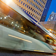 Metro bus in motion at 10th & Main Transit Center, downtown Kansas City, MO.