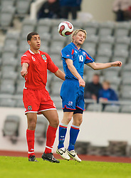 REYKJAVIK, ICELAND - Wednesday, May 28, 2008: Wales' Lewin Nyatanga and Iceland's Gunnar Heidar Thorvaldsson during the international friendly match at the Laugardalsvollur Stadium. (Photo by David Rawcliffe/Propaganda)