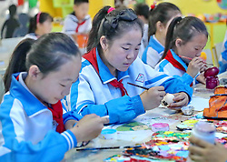 May 25, 2017 - Qinhuangdao, Qinhuangdao, China - Qinhuangdao, CHINA-May 25 2017: (EDITORIAL USE ONLY. CHINA OUT)..Pupils paint colorful eggs at a primary school in Qinhuangdao, north China's Hebei Province, May 25th, 2017, marking the upcoming Dragon Boat Festival. (Credit Image: © SIPA Asia via ZUMA Wire)