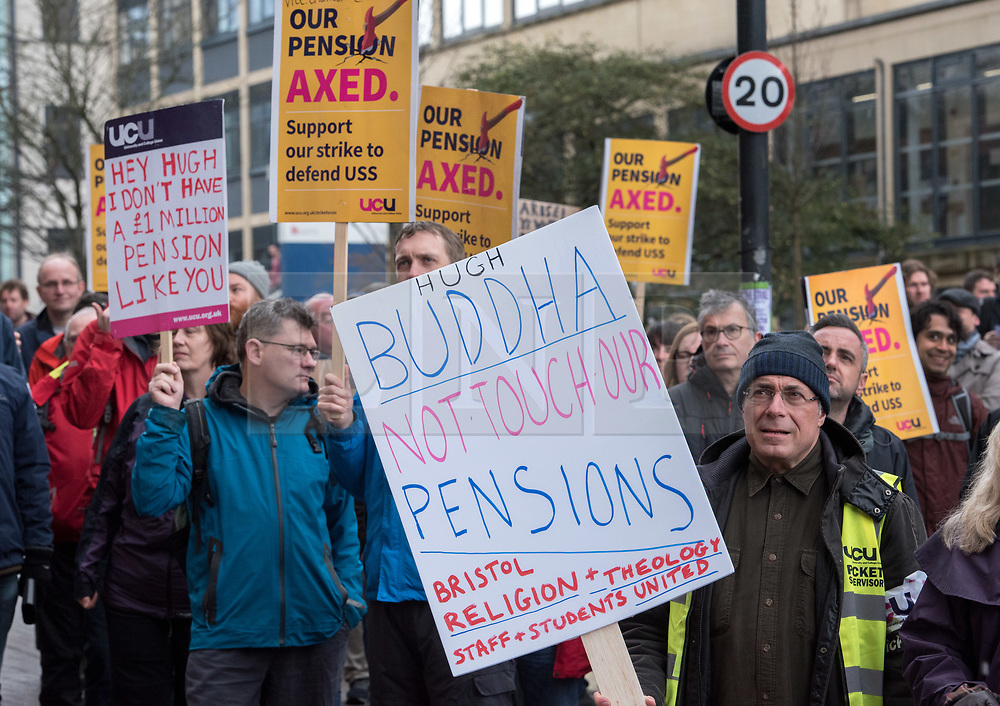 © Licensed to London News Pictures. 12/03/2018. Bristol, UK. University and College Union (UCU) nation wide strike. A placard directed at Professor Hugh Brady, Vice-Chancellor and President of the University of Bristol, at a strike rally outside the university administrative centre Senate House. UCU lecturers begin a fourth week of strikes at the University of Bristol. Lecturers and other university staff are holding an escalating wave of strikes over a four-week period at 61 universities across the country over a change in their pensions. The dispute centres on proposals to end the defined benefit element of the Universities Superannuation Scheme (USS) pension scheme. UCU says this would leave a typical lecturer almost £10,000 a year worse off in retirement than under the current set-up. Photo credit: Simon Chapman/LNP