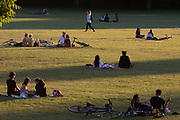 The number of UK deaths from Coronavirus, a further 363 victims taking the total to 35,704, coincided with the hottest day of the year so far, with 27.8 degrees recorded at Heathrow Airport, and Londoners - still under the UK government's lockdown rules of social distancing - enjoyed a warm evening in Ruskin Park in Lambeth, south London, on 20th May 2020, in London, England.