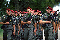 French Paratroopers marching at a world war two memorial service in Sennecy-Le-Grand 1988. They are equipped with FAMAS assault rifles alongside attached ceremonial bayonets. Photograph by Terry Fincher
