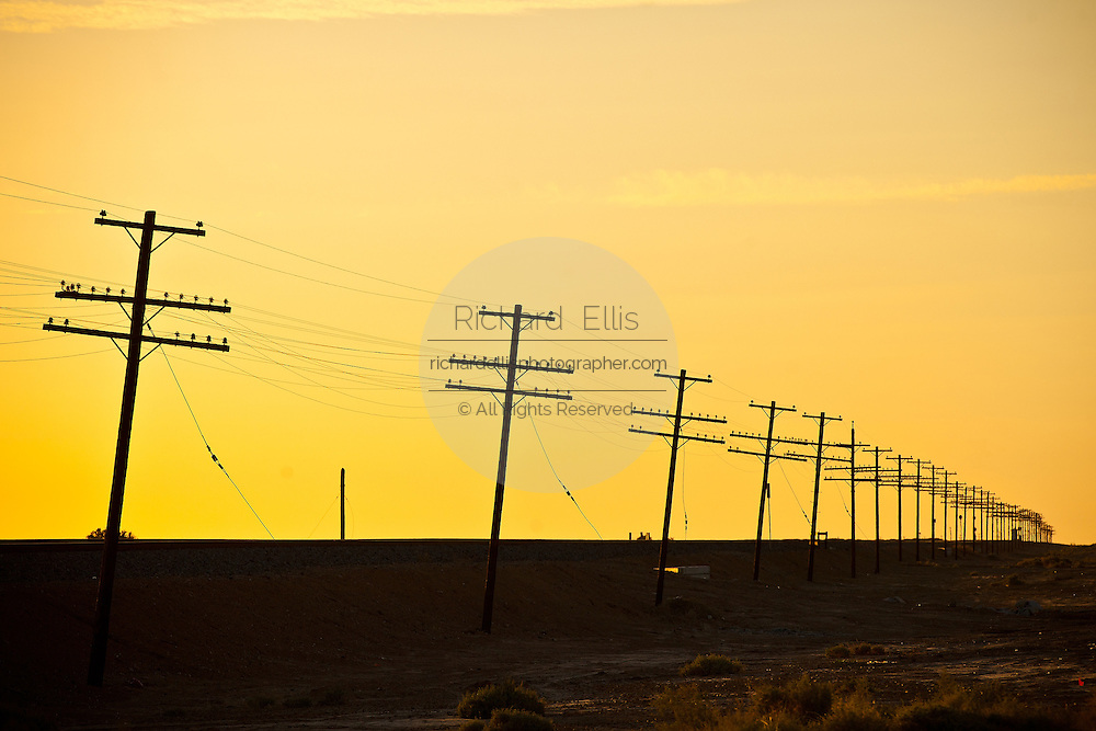 Endless line of telephone poles along the coast of the Salton Sea Imperial Valley, CA.