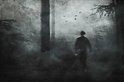 Moody forest in black and white with dancing man