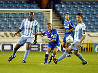 Fotball<br /> England 2005/2006<br /> Foto: SBI/Digitalsport<br /> NORWAY ONLY<br /> <br /> Millwall v Coventry City. Coca Cola Championship.<br /> 09/08/2005.<br /> Jody Morris of Millwall sweepos the ball away from Dele Adebola and Stephen Hughes of Millwall