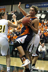 19 March 2010:Carrie Snikkers takes an off balanced shot after slipping past Melissa Alwardt. The Flying Dutch of Hope College defeat the Yellowjackets of the University of Rochester in the semi-final round of the Division 3 Women's Basketball Championship by a score of 86-75 at the Shirk Center at Illinois Wesleyan in Bloomington Illinois.