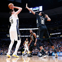 01 April 2018: Denver Nuggets center Nikola Jokic (15) takes a jump shot over Milwaukee Bucks center John Henson (31) during the Denver Nuggets 128-125 victory over the Milwaukee Bucks, at the Pepsi Center, Denver, Colorado, USA.