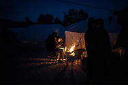 Men warming them selfs next to fire. About 20000 are living in a makeshift camp nearby the city of Moria on the island of Lesbos in miserable conditions, most of the without water, electricity nor sanitary facilities.  Federico Scoppa