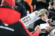 an Anfield Road street sign is held up as Jürgen Klopp, the Liverpool manager signs autographs. The Emirates FA cup, 4th round replay match, West Ham Utd v Liverpool at the Boleyn Ground, Upton Park  in London on Tuesday 9th February 2016.<br /> pic by John Patrick Fletcher, Andrew Orchard sports photography.