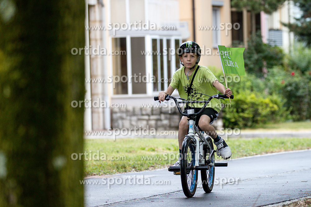 Kid with bicycle and a flag 4th Stage of 26th Tour of Slovenia 2019 cycling race between Nova Gorica and Ajdovscina (153,9 km), on June 22, 2019 in Slovenia. Photo by Matic Klansek Velej / Sportida