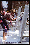 Tim Hayden of Owensboro,KY whitewashes 'fence' at Fence Painting Contest;Tom Sawyer Days;Hannibal Missouri