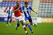 Wigan Athletic defender Scott Wootton (14) and Charlton Athletic midfielder Chuks Aneke (10) during the EFL Sky Bet League 1 match between Wigan Athletic and Charlton Athletic at the DW Stadium, Wigan, England on 2 March 2021.