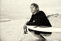 2013 April 20: Nick Tudor, a surfer in Wrightsville Beach, NC.
