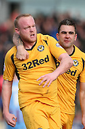Newport's Lee Minshull (left) celebrates his goal with Andy Sandell. Skybet football league 2 match, Newport county v Scunthorpe Utd at Rodney Parade in Newport, South Wales on Saturday 1st March 2014.<br /> pic by Mark Hawkins, Andrew Orchard sports photography.