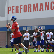 Quarterback Eli Manning in action at training during the 2013 New York Giants Training Camp at the Quest Diagnostics Training Centre, East Rutherford, New Jersey, USA. 29th July 2013. Photo Tim Clayton.
