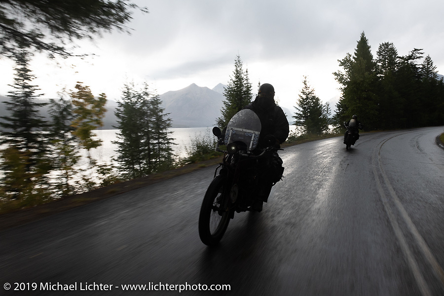 Clint Funderburg riding his 1916 Indian Powerplus through the rain in Glacier National Park during the Motorcycle Cannonball coast to coast vintage run. Stage 12 (242 miles) from Great Falls to Kalispell, MT. Thursday September 20, 2018. Photography ©2018 Michael Lichter.