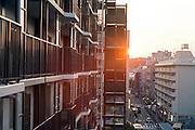 residential high rise apartment building n Yokohama Japan at sunset
