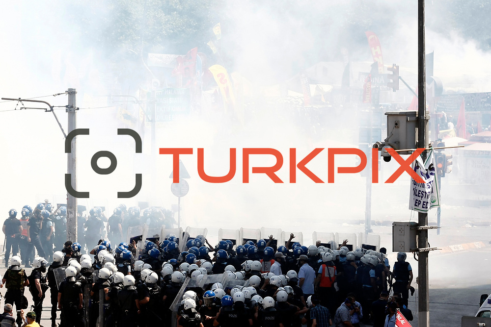 Turkish riot police secure the area during a protest at Taksim Square in Istanbul June 11, 2013. Riot police fired water cannon and teargas at hundreds of protesters in Istanbul's Taksim Square on Tuesday, Reuters witnesses said, entering the square for the first time since demonstrations against plans to develop a park there turned violent. Photo by AYKUT AKICI/TURKPIX