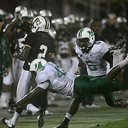 Central Florida quarterback Jeff Godfrey (2) runs out of bounds as Marshall defensive lineman Trevor Black (43) dives for him during an NCAA football game between the Marshall Thundering Herd and the Central Florida Knights at Bright House Networks Stadium on Saturday, October 8, 2011 in Orlando, Florida. (Photo/Alex Menendez)