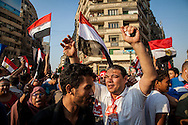 Jubilant crowds hear news of Egyptian president Morsi's arrest. Tahrir Square, Cairo, Egyot.