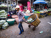 17 MAY 2013 - BANGKOK, THAILAND:   The Bangkok Flower Market (Pak Klong Talad) is the biggest wholesale and retail fresh flower market in Bangkok. It is also one of the largest fresh fruit and produce markets in the city. The market is located in the old part of the city, south of Wat Po (Temple of the Reclining Buddha) and the Grand Palace.   PHOTO BY JACK KURTZ