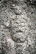 extreme close up of the face of a stone sculpture Japan