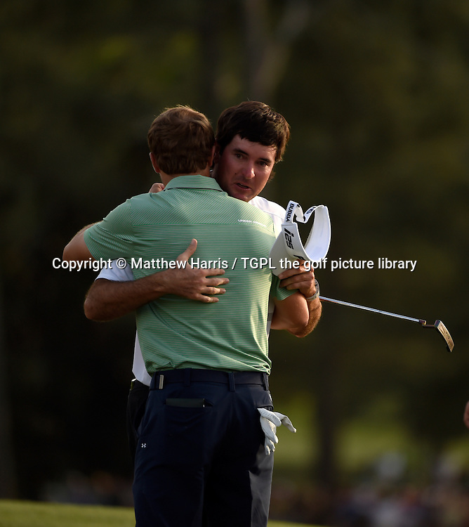 Bubba WATSON (USA)  hugs with Jordan SPIETH (USA) after winning his second Masters title during fourth round US Masters 2014,Augusta National,Augusta, Georgia,USA.