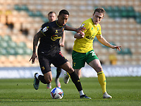Football - 2020 / 2021 Sky Bet Championship - Norwich City vs Watford - Carrow Road<br /> <br /> Joao Pedro of Watford holds off the challenge from Oliver Skipp of Norwich City.<br /> <br /> COLORSPORT