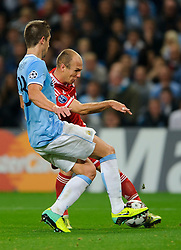 Bayern Forward Arjen Robben (NED) is challenged by Man City Defender Matija Nastasic (SRB) during the second half of the match - Photo mandatory by-line: Rogan Thomson/JMP - Tel: Mobile: 07966 386802 - 02/10/2013 - SPORT - FOOTBALL - Etihad Stadium, Manchester - Manchester City v Bayern Munich - UEFA Champions League Group D.