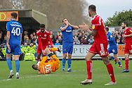 Accrington Stanley goalkeeper Dimitar Evtimov (30) saving and AFC Wimbledon striker James Hanson (18) with hands to his mouth during the EFL Sky Bet League 1 match between AFC Wimbledon and Accrington Stanley at the Cherry Red Records Stadium, Kingston, England on 6 April 2019.