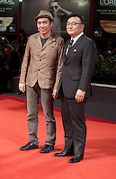 Director Kim Ji-woon and producer Choi Jae-Won at the premiere of the film Brimstone at the 73rd Venice Film Festival, Sala Grande on Saturday September 3rd 2016, Venice Lido, Italy.