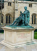 "This statue outside of York Minster honors Constantine the Great (or Saint Constantine, AD 274 - 337) who was proclaimed Roman Emperor in York in AD 306. York is in North Yorkshire, England, United Kingdom, Europe. Constantine was a Roman Emperor of Illyrian-Greek origin from 306 to 337. While campaigning under his father in Britannia (Britain), Constantine was acclaimed as emperor by the army at Eboracum (modern-day York) after his father's death in 306 AD. He emerged victorious in a series of civil wars against Emperors Maxentius and Licinius to become sole ruler of both west and east by 324 AD. Among his many major reforms, Constantine separated the civil and military authorities. To combat inflation, he introduced a new gold coin, the solidus, the standard for Byzantine and European currencies for more than a thousand years. Constantine was the first Roman emperor to convert to Christianity, and he played an influential role in the proclamation of the Edict of Milan in 313, which declared religious tolerance for Christianity in the Roman empire. He called the First Council of Nicaea in 325, at which the Nicene Creed was adopted by Christians. Constantine pursued successful campaigns against the tribes on the Roman frontiers—the Franks, the Alamanni, the Goths, and the Sarmatians—even resettling territories abandoned by his predecessors during the Crisis of the Third Century. He built a new imperial residence at Byzantium and renamed the city Constantinople after himself. It became the capital of the Empire for more than a thousand years, and the later Eastern Empire was known as the Byzantine Empire. He replaced Diocletian's tetrarchy with the principle of dynastic succession by leaving the empire to his sons. He is venerated as a saint by Eastern Orthodox and Byzantine Catholics. Historically, he has been called the ""First Christian Emperor"" for his promotion of the Christian Church, but some modern scholars d"