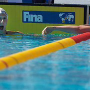Mary Descenza, USA, (left) breaks the world record swimming next to Jessicah Schipper, Australia, in the Women's 200m Butterfly heats at the World Swimming Championships in Rome on Wednesday, July 29, 2009. Photo Tim Clayton.