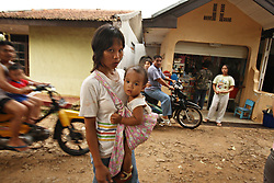"""Dian Dama Yanthi, 32, and her child Gilang Rama, 1, are seen on the outskirts of Jakarta, Indonesia, April 19, 2006. Dian had an unsafe abortion and lost her best friend to an unsafe abortion. Both took the traditional medicine """"jamu."""" Dian also had a massage from a traditional birthing attendant. Over two million abortions are performed in Indonesia every year, many by unskilled practitioners. Thousands of women survive but often with life-long disabilities. It is said by doctors and activists that a woman dies every hour in Indonesia due to unsafe abortions."""