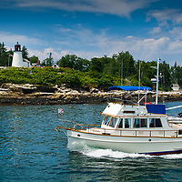 Classic photo of the Burnt Island Lighthouse in Boothbay Harbor Maine.