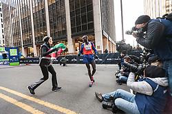 Mutai wins, Whiteenberg drapes Kenya flag as photographers capture