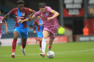 Sam Hart brings the ball forward during the EFL Sky Bet League 1 match between Scunthorpe United and Rochdale at Glanford Park, Scunthorpe, England on 8 September 2018.