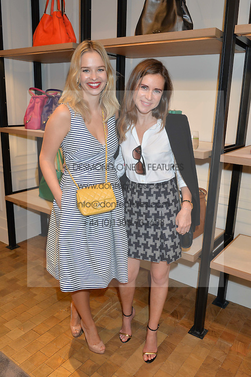 Left to right, MARISSA HERMER and SOPHIE GOODWIN at a lunch hosted by Alice Naylor-Leyland and Tamara Beckwith in celebration of the Coach 2015 collection held at Coach, New Bond Street, London on 18th September 2014.