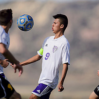 Miyamura Patriot Matthew Ruis (9) gets clear of the Kirtland Central Broncos to stop the ball Tuesday at Miyamura High School.