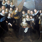 Militia Company of District XIX under the Command of Captain Cornell Bicker Joachim von Sandrart (1606-1688) oil on canvas, 1640.  When the French Queen Mother, Maria de 'Medici visited Amsterdam in 1638, Captain Bicker's company served as her guard of Honour.  The German artist Sandrart thus arranged the militiamen around a portrait bust of the queen in this group portrait.  The painting was made to measure for the large hall of the Kloveniersdoelen.