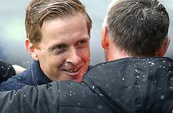 Birmingham City's manager Garry Monk hugs Hull City's manager Nigel Adkins