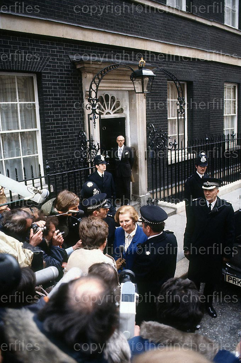 Margaret Thatcher,MP seen outside No 10 Downing Street, London as she arrives after her victory in the 1983 General Election. Her husband Dennis Thatcher is seen standing on the steps behind her. Photograph by Jayne Fincher